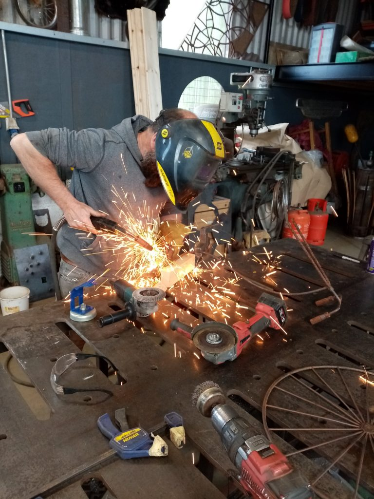 Billy Moore welding back wheel on penny-farthing