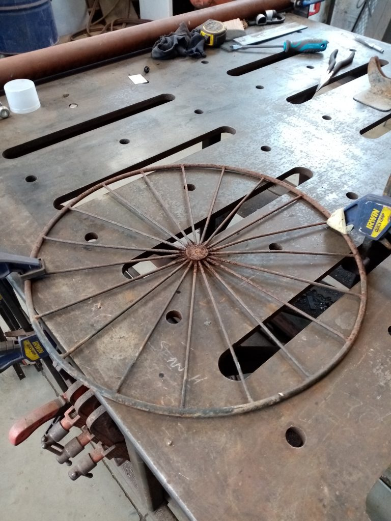 Preparing the wheel to be cleaned with wire brush.